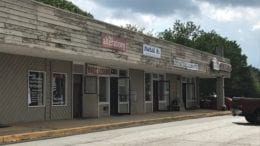 Sprayberry Crossing row of dilapidated storefronts -- there will be a hearing on redevelopment of the property