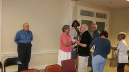 District 3 Commissioner JoAnn Birrell talks with constituents after the town hall (photo by Larry Felton Johnson)