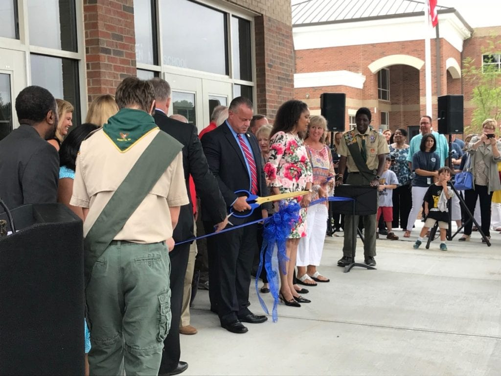 Brumby's senior teachers join Superintendent Ragsdale for the ribbon cutting. (photo by Rebecca Gaunt)