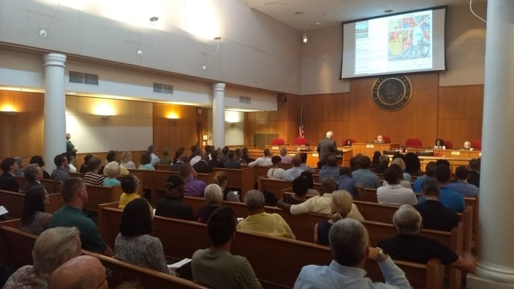 Smyrna Community Development Director Ken Suddreth speaks in front of a packed house at City Hall Monday night (photo by Haisten Willis)