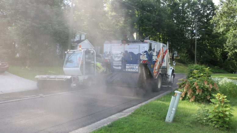 paving equipement generating smoke and dust in article on weekly travel advisiory