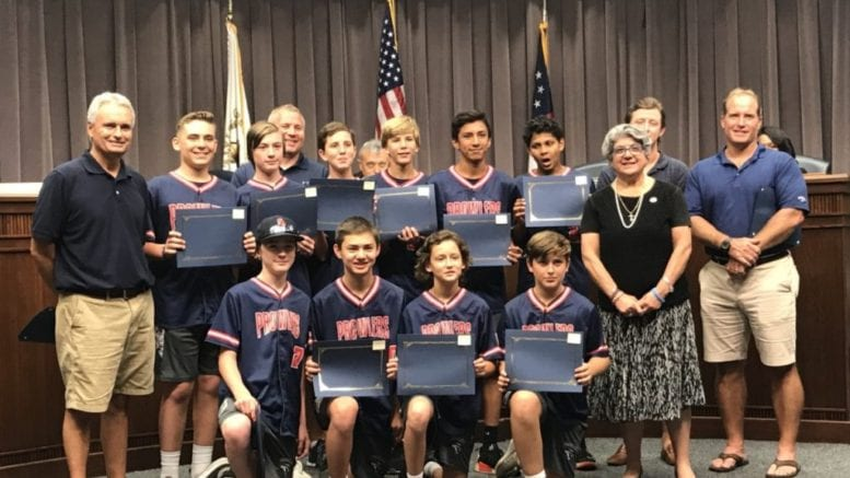 Commissioner JoAnn Birrell congratulated the Sandy Plains Prowlers travel baseball team who finished its season with a 65-11 record and five championships. (photo by Rebecca Gaunt) in article about new Cobb police headquarters