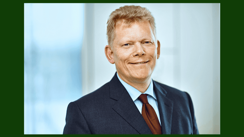 Guido Kerkhoff, Chairman of the Executive Board of thyssenkrupp in dark suit with red tie, in article about third-quarter loss in Industrial Services division.