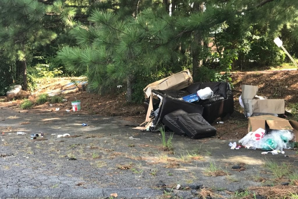Bags of trash and other debris on Sprayberry Crossing property