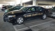 Cobb County Police car in article about Austell Road fatal shooting