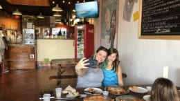 "Local resident Meghan Cooper snaps a selfie with her daughters while enjoying ""Roman style pizza"" at Pizza by Fusco's, one of the participating restaurants in the selfie challenge (photo by Meghan Cooper)"