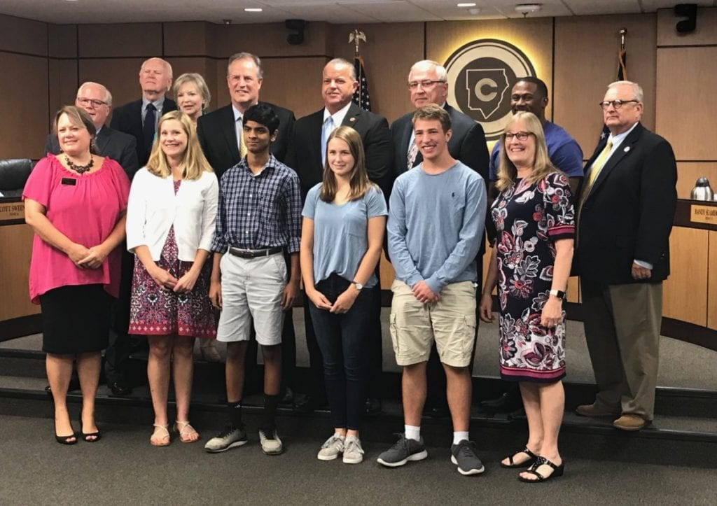 Rishab Rao, Noah Buckner and Alexandra Holdemeyer of Walton High were recognized for their fire safety invention. (photo by Rebecca Gaunt)