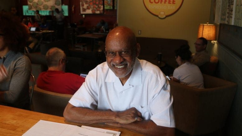 Lawrence King, Cobb EMC board candidate, at Rev Coffee Roasters (photo by Larry Felton Johnson)