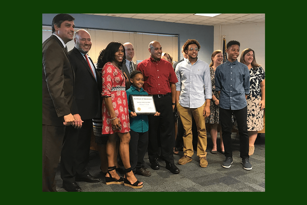 Student of the month Michael Poche and his family were recognized by the board. (photo by Rebecca Gaunt)