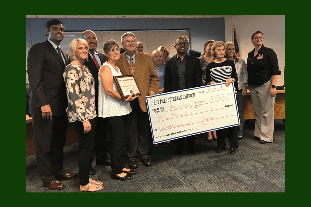 First Presbyterian Church presented a check for $15,000 dollars for the Emily Lembeck Early Learning Center to the board and employee of the month Maren Roedenbeck (far right). (photo by Rebecca Gaunt)