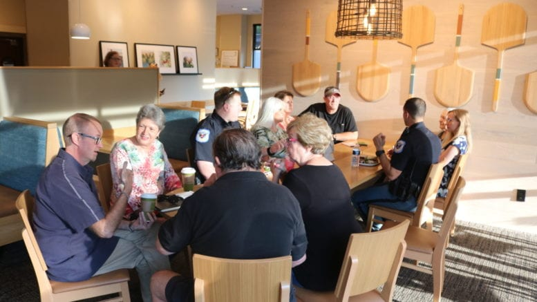 Officers Penirelli and Conwell chat with neighbors at Cobb police Precinct 2 Coffee with a Cop day (photo by Larry Felton Johnson)