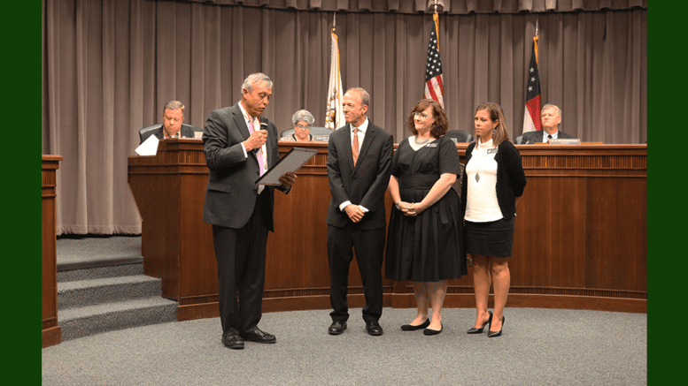 Chairman Michael Boyce reads proclamation to DUI court judge and coordinators