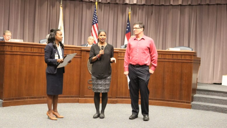 Commissioner Lisa Cupid, Ericka Smith, and Dr. Scott Hamilton at the Board of Commissioners meeting at the reading of the Dyslexia Awareness Month proclamation.