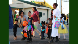 photo of children in costume, with their parents, at a previous Fall Festival of Fun