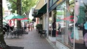 A row of narrow storefronts along Marietta Square, directly across from Glover Park