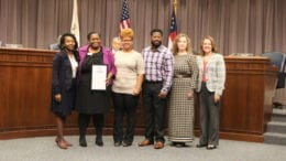 (L-R) Commissioner Lisa Cupid; Lasondra Howard-Boddie, Cobb County Director of DFCS; Everlean Rutherford; Brandon Rutherford; Danielle Farrelley, Resource Development Supervisor, DFCS; Carmen Nance, Cobb County DFCS Deputy Director (photo by Larry Felton Johnson)