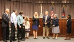 Erica Parish, surrounded by family and commissioners, accepts appointment as Cobb DOT director (photo by Larry Felton Johnson)