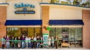 Ribbon-cutting ceremony for the opening of the expanded Sabores Boutique Cafe (photo by Hastings Huggins provided by the Mableton Improvement Coalition)