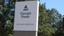 Georgia Power sign at Plant McDonough-Atkinson in Cobb County accompanying article about bill requiring lined pits for coal ash