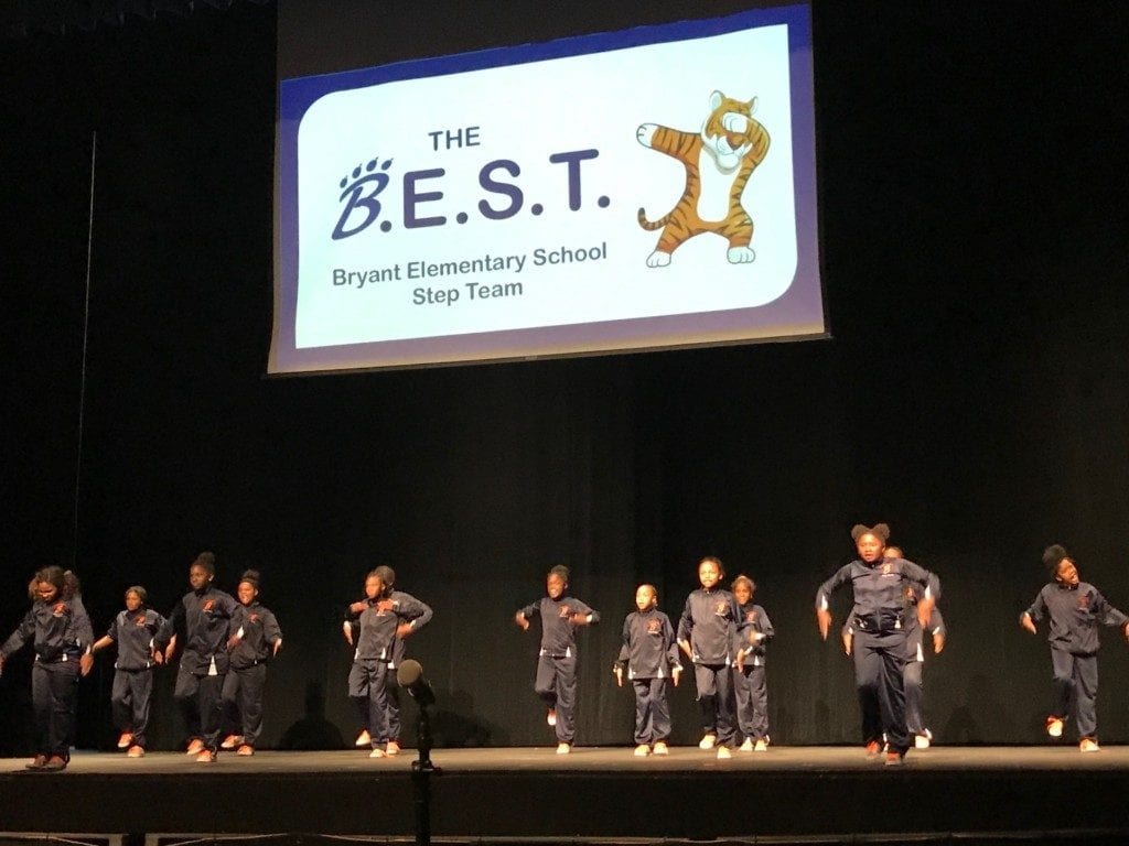 The Bryant Elementary School girls' step team opened the meeting to a very positive reception in what was an otherwise tense gathering.