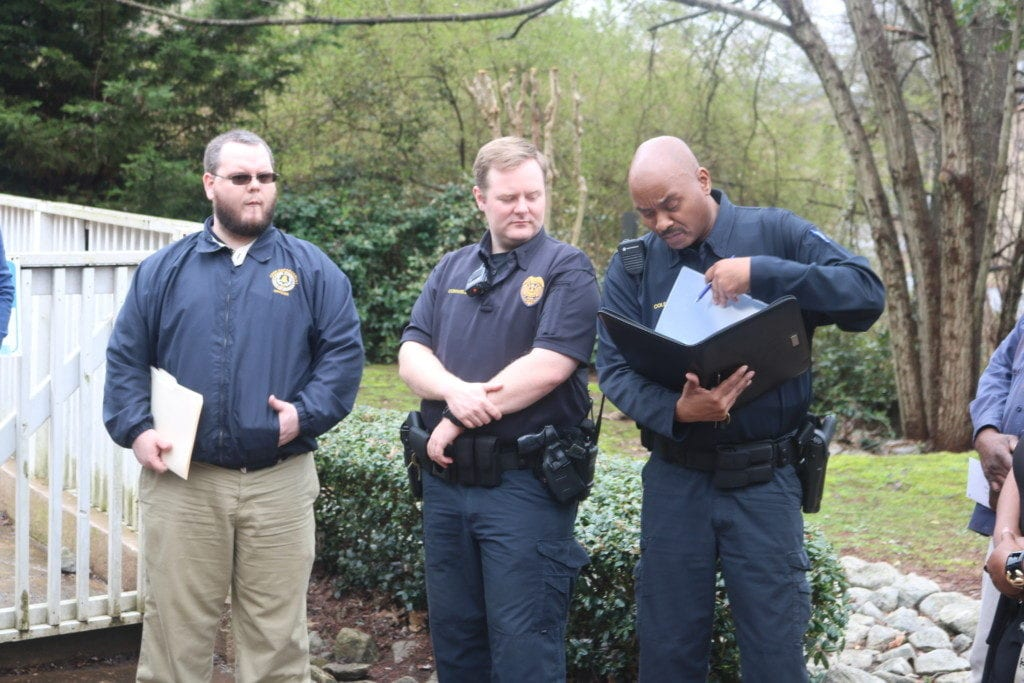 L-R, Brent Farrell from Cobb County code enforcement, Officers Conwell and Cole from community affairs in Precinct 2 of the Cobb County Police Department (photo by Larry Felton Johnson)