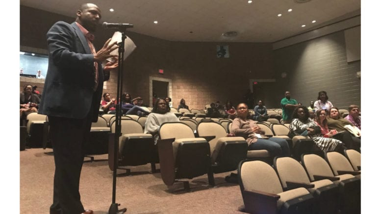 Gregory George addressed several concerns regarding planned SPLOST projects and implored families to stay involved with the issue -- photo from Pebblebrook High School town hall.
