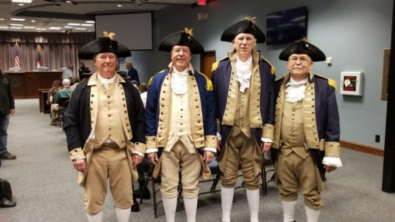 Stallings Howell, Bill Floyd, Wayne Brown and Shep Hammack in American Revolutionary War uniformsfrom the Sons of the American Revolution at the Cobb Board of Commissioners meeting to receive a proclamation for Patriots Day