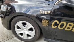 Detail of Cobb County Police Department STEP Unit vehicle in article about accident at Cooper Lake Road