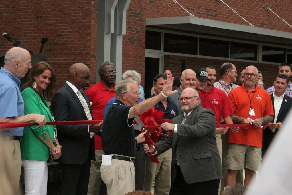 City of Acworth Mayor Tommy Allegood and Cobb County Support Services Director Eddie Canon cutting the ribbon on the Acworth Community Center (photo by Alex Patton)