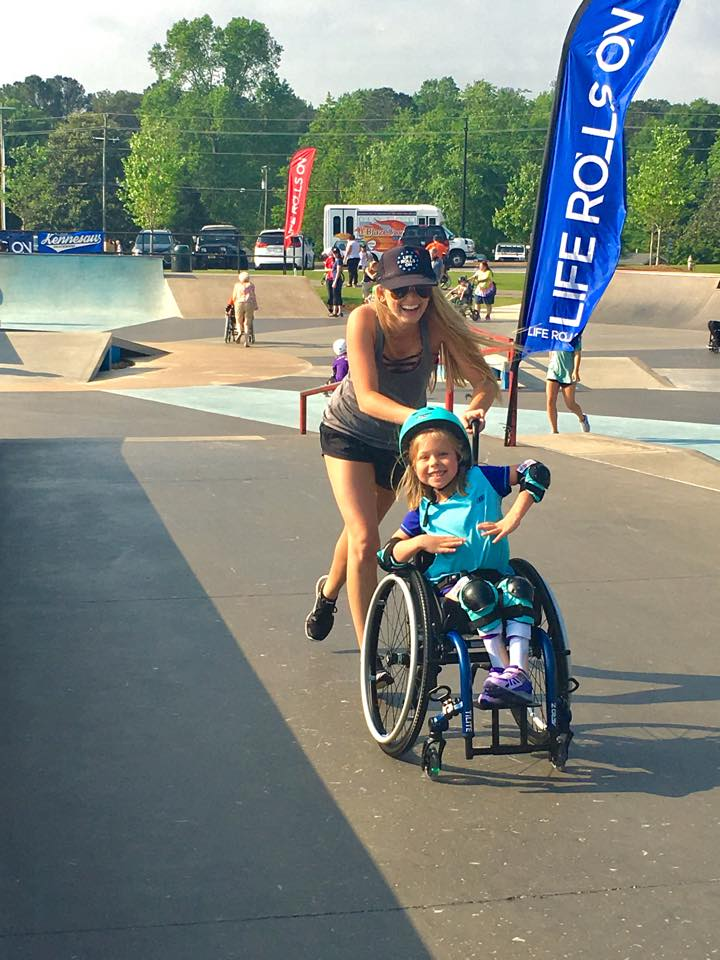 Life Rolls On photo of child in wheelchair