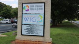 Sign in front of Cobb & Douglas Public Health on County Services Parkway in article about COVID-19 public health alert