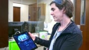 Amy Woodell, Evidence-Based Coordinator for Cobb Senior Services demonstrates security features on an iPad at the Assistive Technology Lab located at Senior Wellness Center at 1150 Powder Springs Street in Marietta. Visitors are invited to schedule tours of the AT Lab to learn about products that improve the quality of life for seniors and people of any age that may need. (photo by Margaret Waage