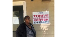"Cobb District 4 candidate Monica DeLancy stands in front of the Thrive Resources Center in Austell, Georgia at Kingsley Village Park Apartments. DeLancy founded ""We Thrive"" to empower renters through the education of their rights and advocacy."