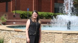 Sarah Shurden in front of the fountain at Austell's Threadmill complex