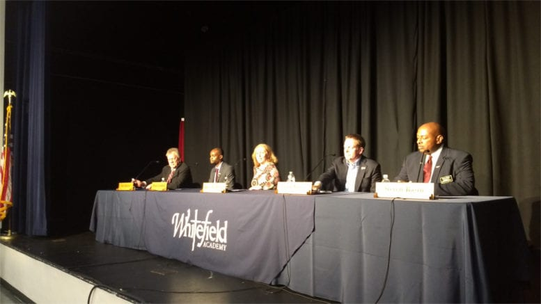 panel of Smyrna mayoral candidates sitting at table