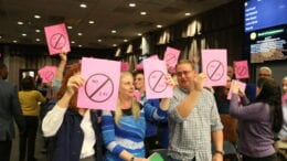 Neigbors holding signs at BOC meeting about Chastain Road development