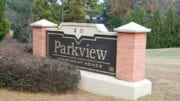 Parkview Apartments, brick sign in front of the complex in article about the purchase of three complexes by Lexington Austell