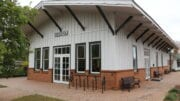 Smyrna History Museum building is a replica of a one-story wooden train station. In article Smyrna History Museum re-opens