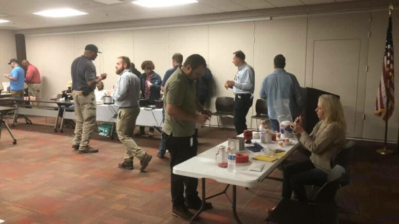Plant McDonough employees serving chili at a benefit for an LGBTQ youth homelessness project