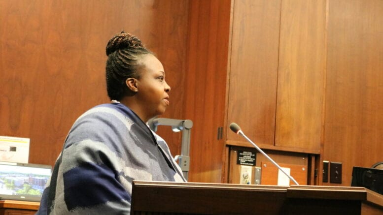 Monica DeLancy at lectern during December Cobb BOC meeting in article about DeLancy endorses Edwards