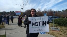 Austin Wagner holding sign on Spring Road