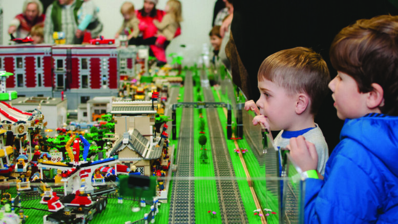 Children watching electric trains from a previous Trains! Trains! Trains! event