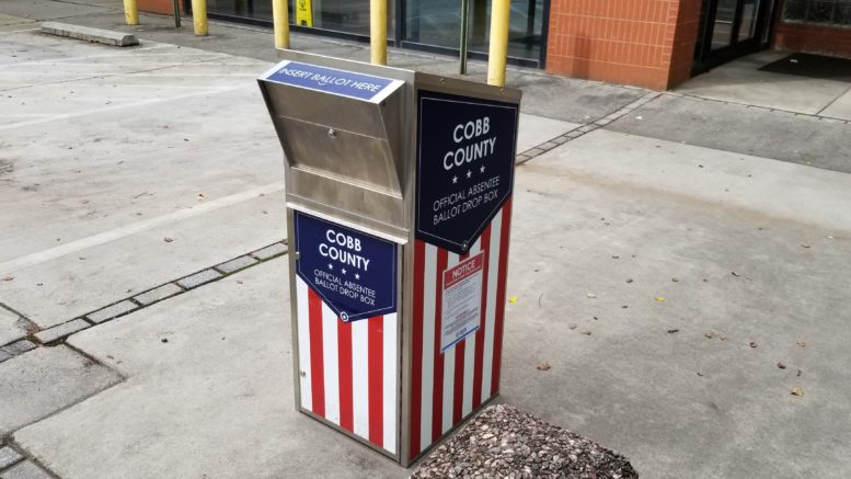 PPE for Cobb poll workers illustrated by photo of ballot box at the South Cobb government center