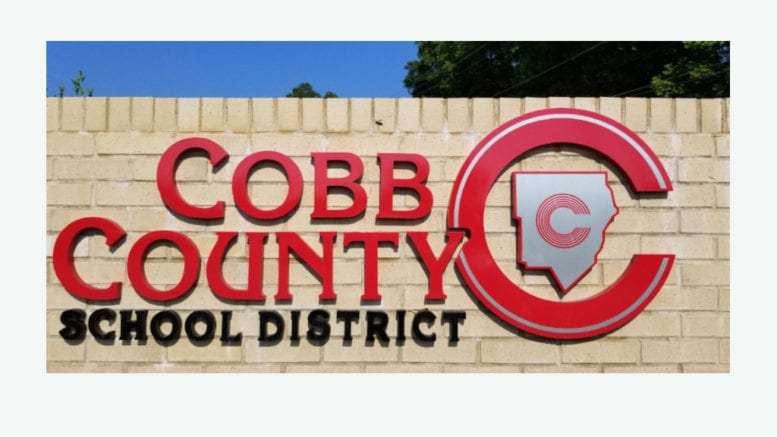 Cobb County School District sign in artilcle about updated opening schedule