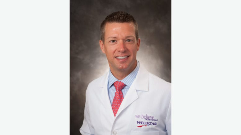 Dr. Danny Branstetter in white medical jacket