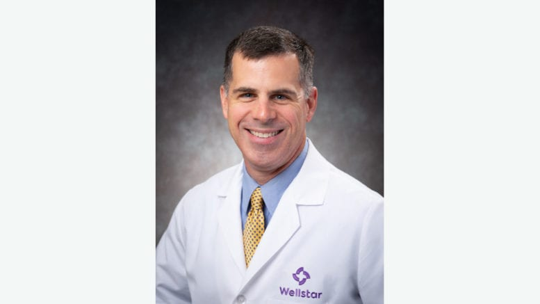 Dr. Andrew Doyle in white jacket
