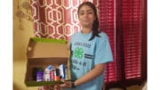 4-H member displaying her gift to mothers in substance abuse recovery (photo courtesy of CCCSB)