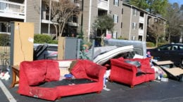 furniture thrown out front after an eviction in article about Eviction Prevention Committee