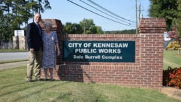 Mayor Derek Easterling and Judi Burrell in front of newly named Dale Burell Complex