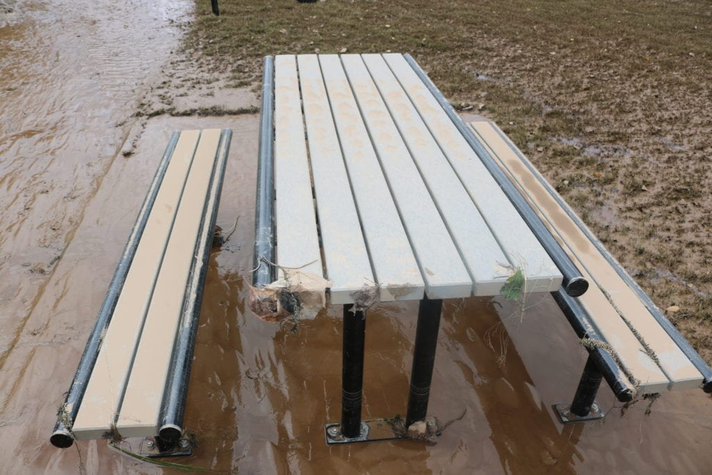 Mud and water around benches on the west side of the path (photo by Larry Felton Johnson)